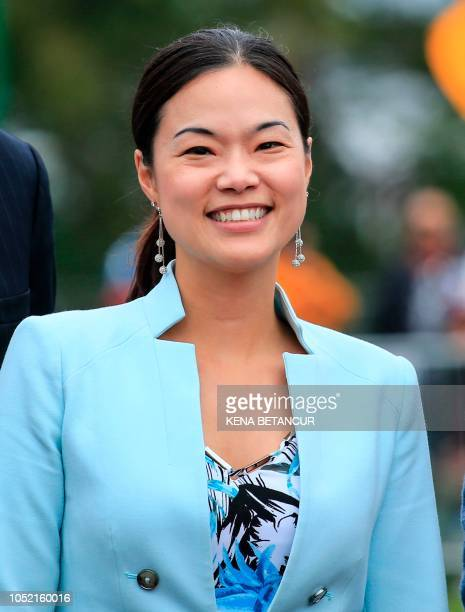 Republican candidate for Congress Pearl Kim poses with a group of Sikhs as she campaigns during the 9th Kabaddi Cup in Upper Darby Pennsylvania on...