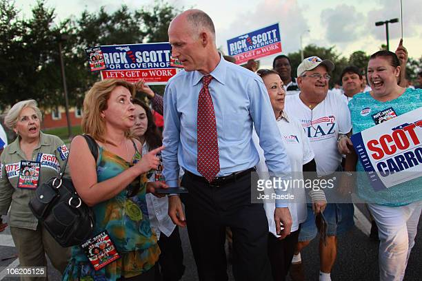 Republican candidate for Florida governor Rick Scott greets people during a campaign stop on October 27, 2010 in Miami, Florida. Scott is facing off...