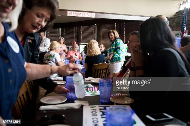Republican candidate for Georgia's 6th Congressional district Karen Handel visits with supporters at the Cherokee Cattle Ranch restaurant in Marietta...