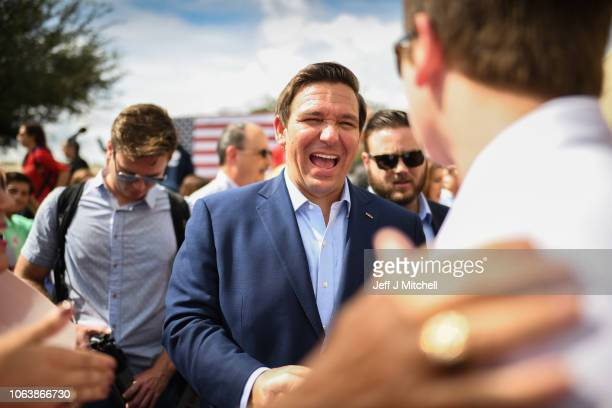 Republican candidate for Governor of Florida Ron DeSantis meets supporters as they attend a rally at Freedom Pharmacy on the final day of campaigning...