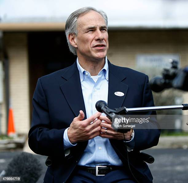 Republican candidate for governor Texas Attorney General Greg Abbott speaks to the press after voting in the Texas primary at Western Hills Church of...