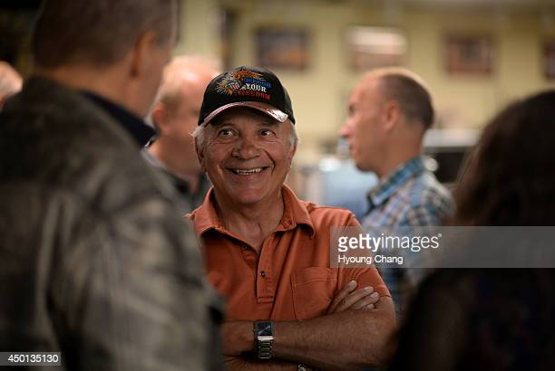 Republican candidate for governor Tom Tancredo is with his supporters at Gunsmoke gun shop Wheat Ridge Colorado June 05 2014