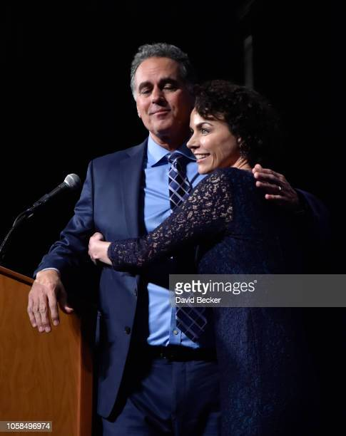 Republican candidate for Nevada's 3rd House District Danny Tarkanian is embraced by his wife Amy Tarkanian after conceding his race against Democrat...