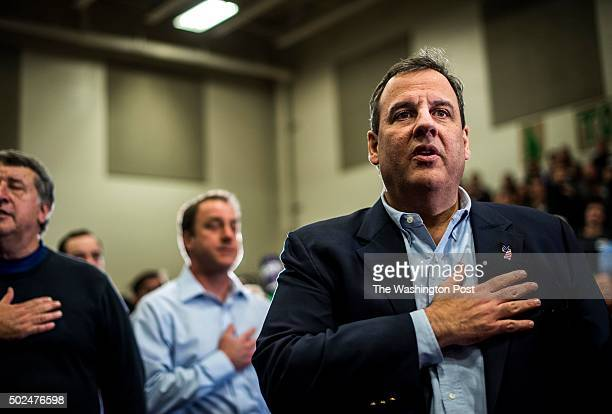 Republican candidate for President and Governor of New Jersey Chris Christie pledges allegiance at a town hall meeting in Bedford New Hampshire on...