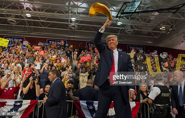 Republican candidate for President Donald J Trump waves a Terrible Towel to supporters at a rally at Ambridge Area Senior High School on October 10...