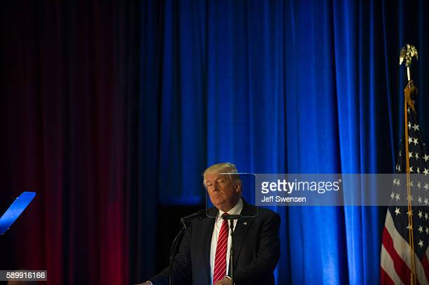 Republican candidate for President Donald Trump is seen through a teleprompter as he holds a campaign event at the Kilcawley Center at Youngstown...