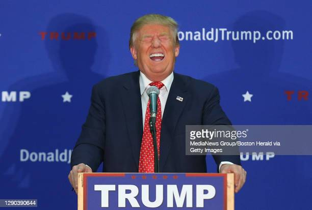 Republican candidate for President Donald Trump laughs as someone in the crowd makes a joke about Hillary Clinton as he speaks at an event in...