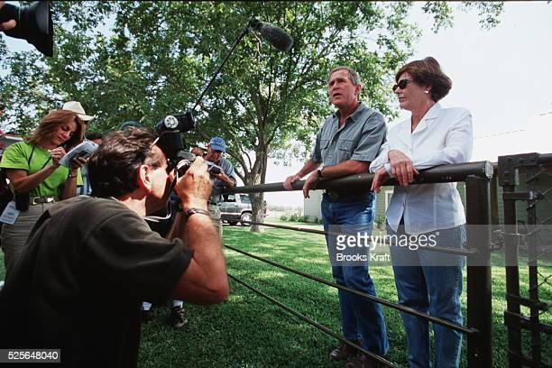 Republican Candidate for President George WBush and his wife Laura answer questions from the press on their ranch in Crawford Texas