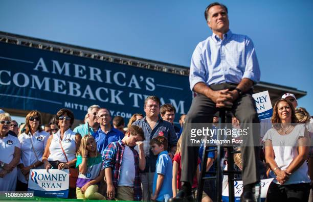 Republican candidate for President Governor Mitt Romney listens to his running mate Vice Presidential Candidate Congressman Paul Ryan at a 5000 in...