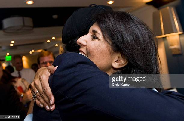 Republican candidate for South Carolina governor Nikki Haley hugs a supporter while watching the runoff election results at the Columbia Sheraton on...