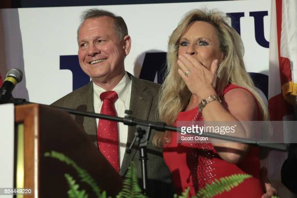 Republican candidate for the US Senate in Alabama Roy Moore and his wife Kayla greet supporters at an electionnight rally on September 26 2017 in...