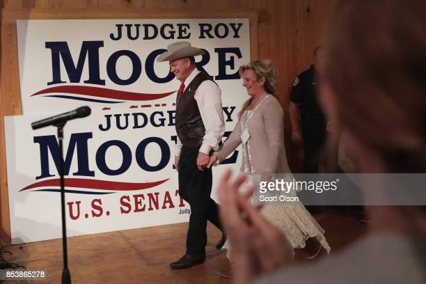 Republican candidate for the US Senate in Alabama Roy Moore arrives at a campaign rally with his wife Kayla on September 25 2017 in Fairhope Alabama...