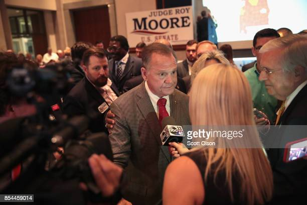 Republican candidate for the US Senate in Alabama Roy Moore speaks to reporters at an electionnight rally after declaring victory on September 26...