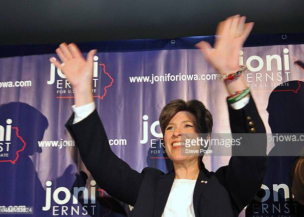 Republican candidate for the U.S. Senate, Joni Ernst, waves before speaking at a rally upon the completion of her tour of all of Iowa's 99 counties...