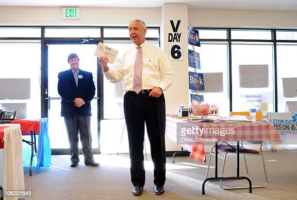 Republican candidate for the US Senate Ken Buck holds his ballot as talks with supporters at the Weld County Victory Office before casting his ballot...