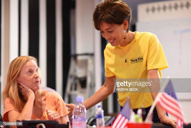 Republican candidate for US Congress Young Kim talks with a voluneer at her campaign office in Yorba Linda California October 6 2018 Kim who...