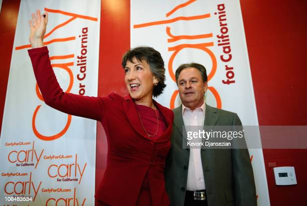 Republican candidate for US Senate and former head of HewlettPackard Carly Fiorina waves goodbye with her husband Frank looking on after she conceded...