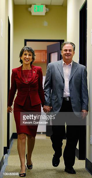 Republican candidate for US Senate and former head of HewlettPackard Carly Fiorina walks out of the kitchen with her husband Frank to concede defeat...