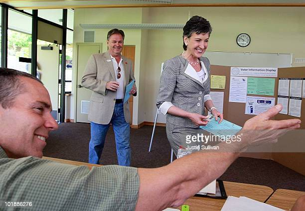 Republican candidate for US Senate and former HP CEO Carly Fiorina and her husband Frank Fiorina arrive at a polling place to vote June 8 2010 in Los...