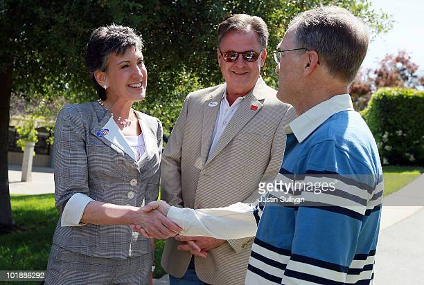 Republican candidate for US Senate and former HP CEO Carly Fiorina and her husband Frank Fiorina greet a voter outside of a polling place June 8 2010...
