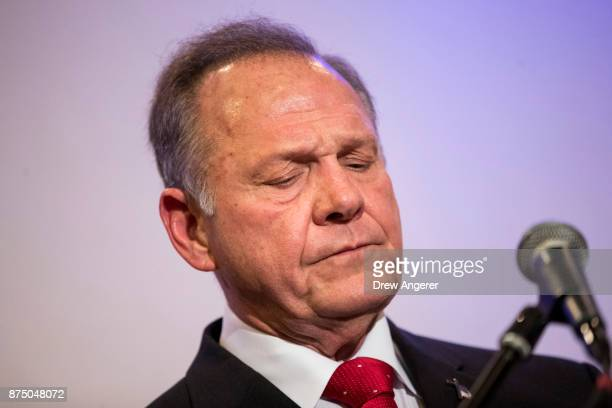 Republican candidate for US Senate Judge Roy Moore pauses while speaking during a news conference with supporters and faith leaders November 16 2017...
