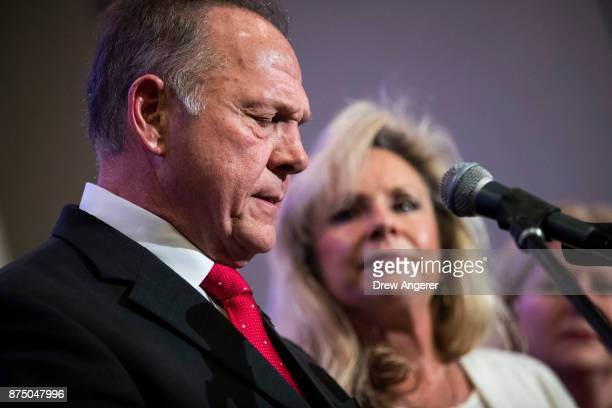 Republican candidate for US Senate Judge Roy Moore speaks as his wife Kayla Moore looks on during a news conference with supporters and faith leaders...