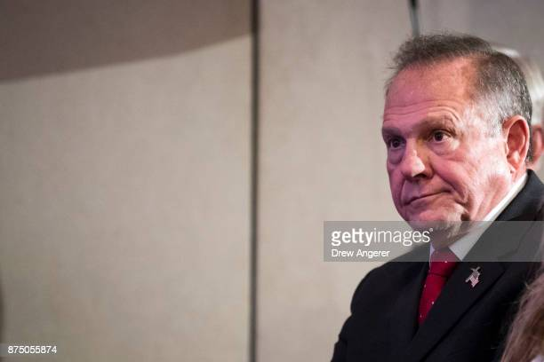 Republican candidate for US Senate Judge Roy Moore waits to speak during a news conference with supporters and faith leaders November 16 2017 in...