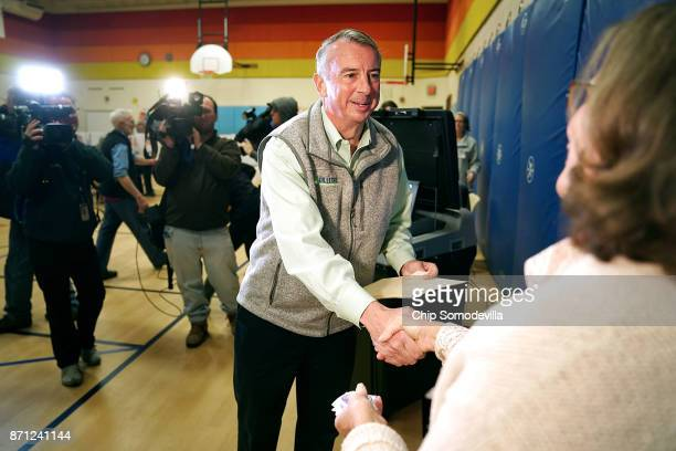 Republican candidate for Virginia governor Ed Gillespie shakes hands with a poll worker after casting his vote in the gymnasium at Washington Mill...