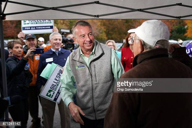 Republican candidate for Virginia governor Ed Gillespie talks with campaign volunteers as he arrives to cast his vote at Washington Mill Elementary...