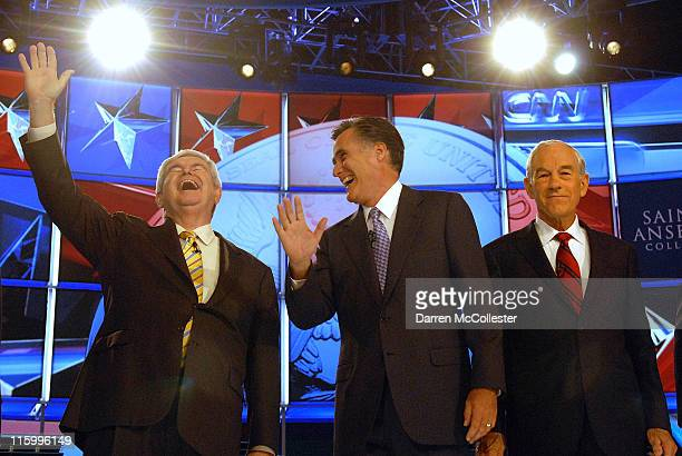 Republican candidates former House Speaker Newt Gingrich laughs along with former Governor Mitt Romney and US Rep Ron Paul prior to their debate June...