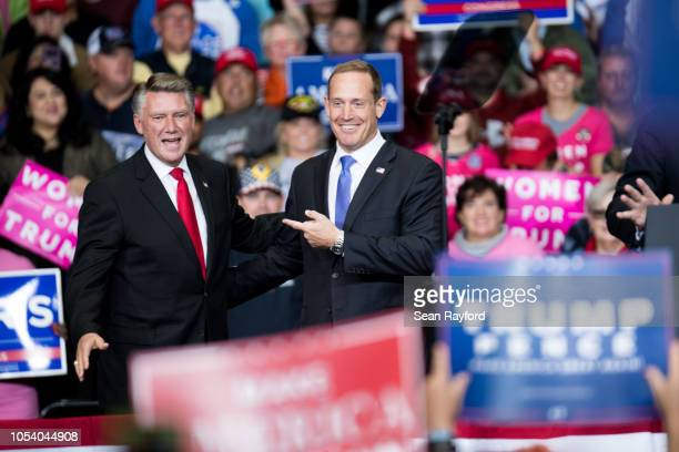 Republican Congressional candidate for North Carolina's 13th district Ted Budd and 9th district Mark Harris are introduced by President Donald Trump...