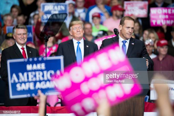 Republican Congressional candidate for North Carolina's 13th district Ted Budd addresses the crowd at a campaign rally while President Donald Trump...