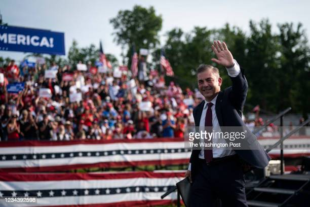 Republican congressional candidate Mike Carey speaks before former President Donald J. Trump arrives to speak at a rally at the Lorain County...