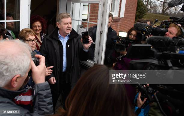 Republican Congressional Candidate Rick Saccone is surrounded by media after voting in the special election to fill the 18th Congressional District...