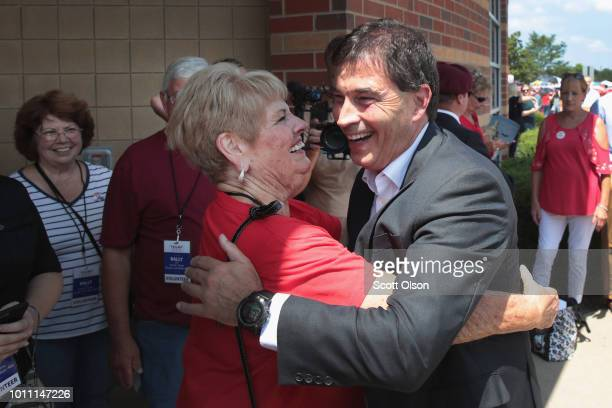 Republican congressional candidate Troy Balderson greets guests before the start of a rally with President Donald Trump August 4, 2018 in Lewis...