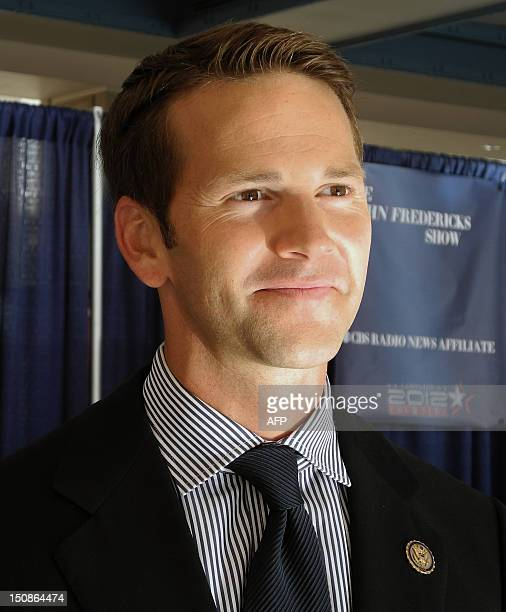 Republican Congressman Aaron Schock of Illinois smiles during an interview with AFP at the Convention Center in Tampa Florida on August 28 2012...