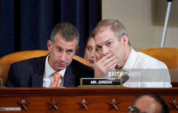 Republican counsel Steve Castor listens to Rep Jim Jordan during a hearing with witness US Ambassador to Ukraine Marie Yovanovitch before the House...