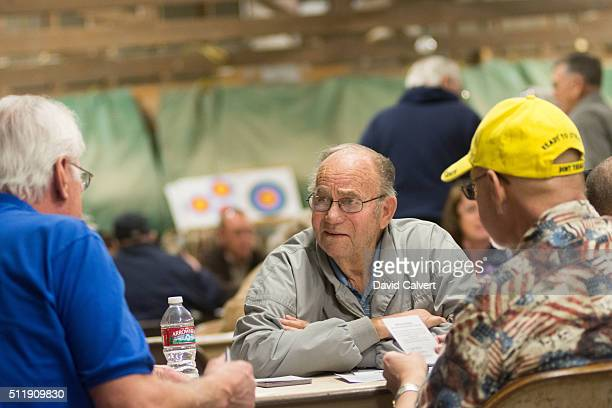 Republican Damian Amaral center participates in the caucus at the Churchill County Fairgrounds on February 23 2016 in Fallon Nevada The remaining...