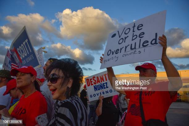 Republican demonstrators gather outside the Broward County Supervisor of Elections headquarters as election workers sort ballots to be recounted...
