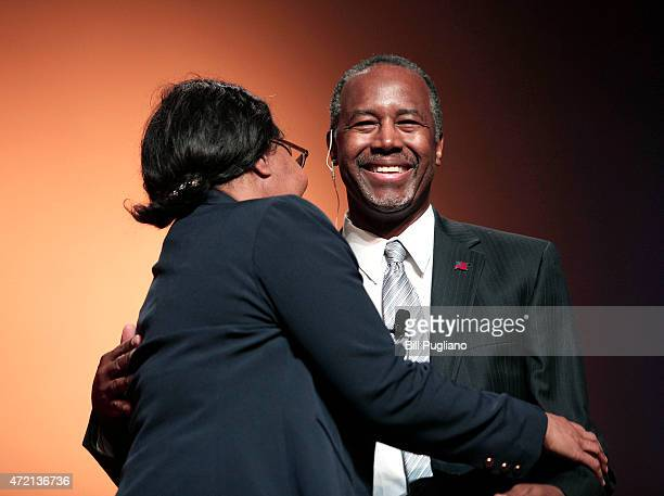 Republican Dr Ben Carson a retired pediatric neurosurgeon hugs his wife Candy as he officially announces his candidacy for President of the United...