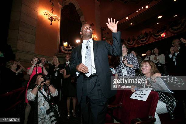 Republican Dr Ben Carson a retired pediatric neurosurgeon waves to supporters before he officially announces his candidacy for President of the...