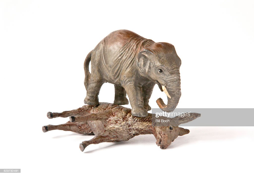 Republican elephant on top of democratic donkey : Stock Photo