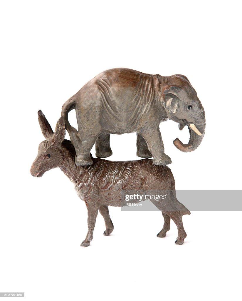 republican elephant standing on democratic donkey stock photo