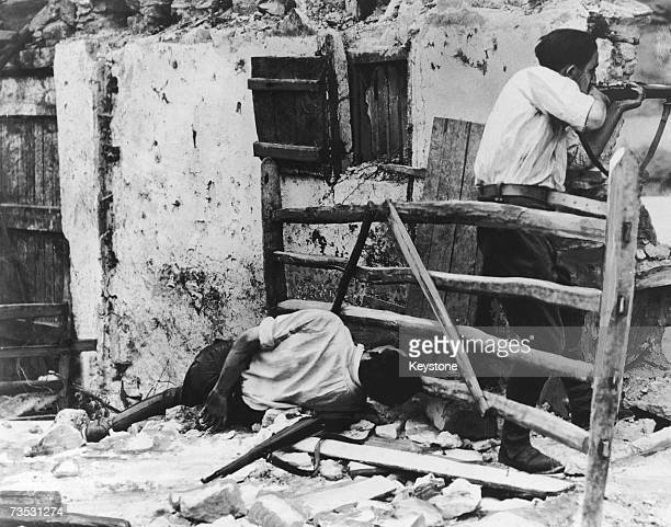 Republican farmer defending a farm on the outskirts of Irun against Nationalist forces during the Spanish Civil War, 6th September 1936. A comrade...