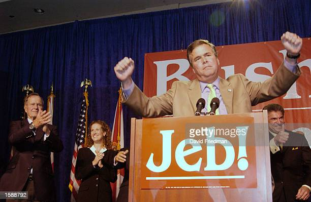 Republican Florida Gov Jeb Bush celebrates with supporters during an election night party November 5 2002 in Miami Florida Democrat opponent Bill...