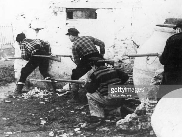 Republican forces lying in ambush in a village near Madrid during the Spanish Civil War