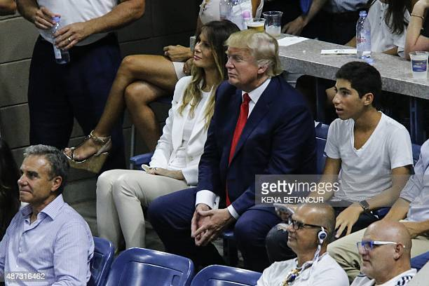 Republican frontrunner Donald Trump and his wife Melania attend a the match of Venus Williams against Serena Williams during their 2015 US Open...