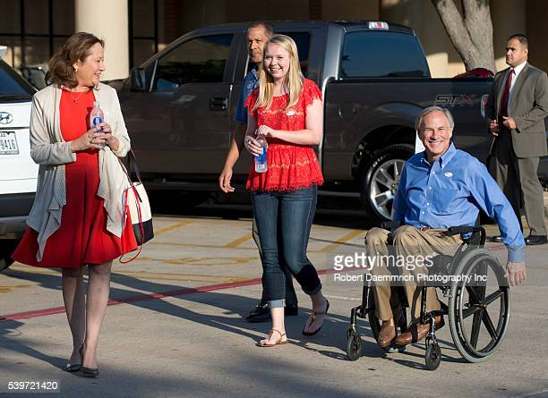 Republican frontrunner for Texas governor Greg Abbott leaves an early voting site with his wife Ceclia and daughter Audrey after casting ballots...