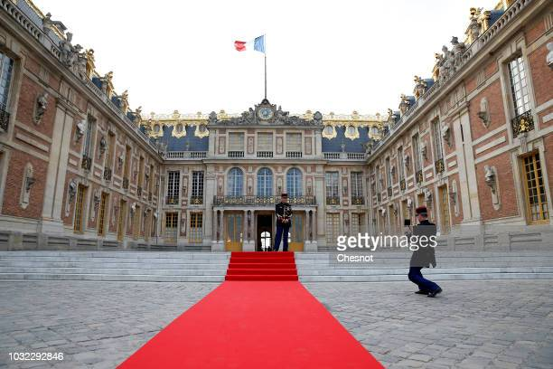 A republican guard poses in the courtyard of the Versailles Palace ahead of the arrival of Japan's Crown Prince Naruhito for a meeting with French...