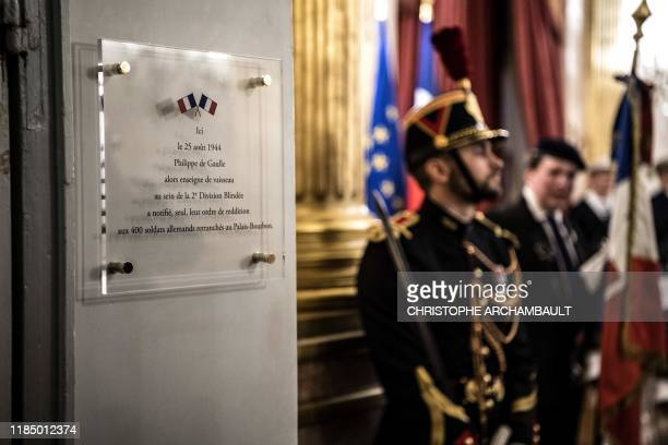 A Republican Guard stands next to a commemorative plaque marking the surrender of the German troops in 1944 after it was unveiled during a ceremony...